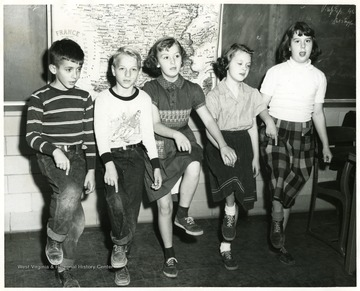 Left to right: Bobby Stone, Vaughn Kovach, Martha Woods, Virginia Wood, Margaret Curtis attending WVU elementary school.