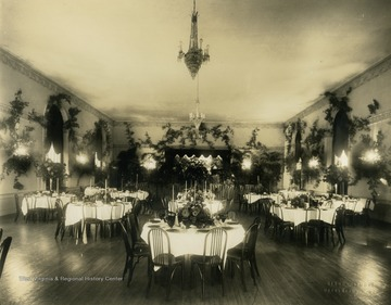 Print number 929. Several tables are decorated in the Hotel Morgan Ballroom in Morgantown, West Virginia.