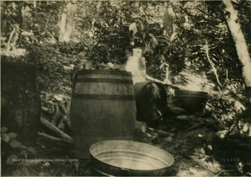 Barrels and other equipment for making moonshine.