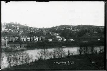 View across Monongahela River of WVU buildings and Seneca section of Morgantown W. Va. Woodburn Hall is at the far right.