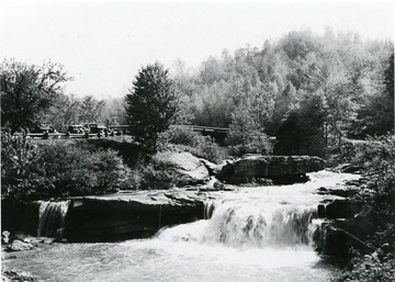 View of falls in Babcock State Park on a clear and sunny day.