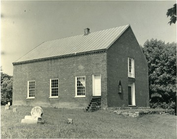 An exterior view of the Christ Church in Bunker Hill. 'Grave of Morgan Morgan to the rear of the edifice.'