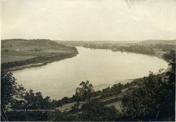 'The Ohio River, showing the bend at Ravenswood and the Ohio side of the river.  Ravenswood in the distance at right.'  From photo album labeled 'Stewart A. Cody, County Agent, Jackson County, 1912.'
