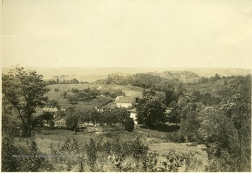 'George Sennett's farm. A typical 'ridge' farm, between Murrayville and Lone Cedar. On the ridges, the farm land is rougher and the farms are further apart.' From photo album labeled 'Stewart A. Cody, County Agent, Jackson County, 1912.'
