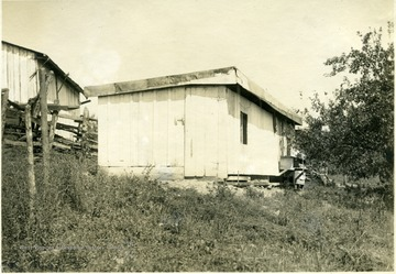 A simple shed-roof poultry house, 10' x 31' with nests and perches. From photo album labeled 'Stewart A. Cody, County Agent, Jackson County, 1912.'