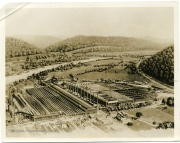 Artists rendering of the Owens Bottle Company (left) and the Owens-Illinois Glass Company (right) at Owens near Charleston W. Va. along the Kanawha River and the Chesapeake and Ohio Railroad main line.