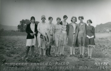 A group portrait of the girls at the Fokker landing field after their first airplane ride.