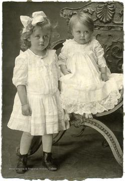 Portrait of Maggie and Helen Ballard in white dresses.