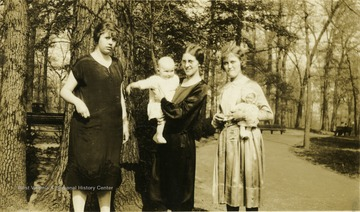 'Isn't the baby cute? - Maggie, Helen and unknown friend of Uncle William and Aunt Lottie.'