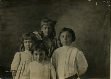 A group portrait with, from top and counter-clockwise, Maggie Ballard, Hellen Ballard, Ellen Spangler, and Florence Spangler.