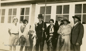 A group photo of Isaac Ballard and his family, and the fish they caught in Florida. Left to Right: 'Jorine, Catherine, Dad, George, Mac, Mrs. Brown, Davy.'