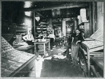 Four employees in W.W. Logan's Print Shop (Back of Welch Daily News Building.)