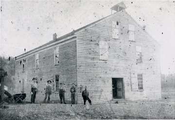 A view of the old wooden mill at Hollywood. The men in the picture are: 'Stewart Vandegrift, Clarence Bostic, Newton Van Stavern, Osbie Surfice, and Amos Vandegrift'.