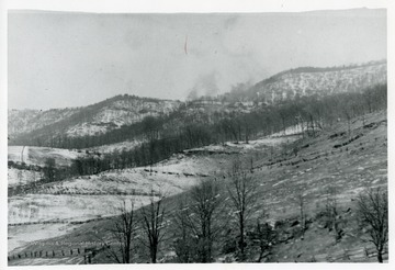 The smoke of a logging train on Spruce Mountain, from Middle Timber Ridge in Pendleton County, West Virginia.