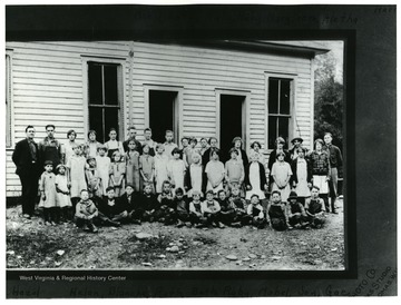 School had two rooms.  Back Row:  Harry Payne (teacher), J.G. 'Bud' Raines, Coy Huffman, Gae Morrell, Evelyn Huffman, Doan Harman, Paul Harper, Ernest Cunningham, Blair Harper, Teddy Adamson, Conley Turner, Mabel Huffman, Kate Raines, Ruby Huffman, Ruby Turner, Mary Huffman, Vera Raines, Aletha Thompson.  Middle Row:  Cathering Harper, Hazel Adamson, Helen Butcher, Blanche Turner, Ruby George, Mabel Huffman, Joy Huffman, Gae Adamson, Rosalie Harper, Ann Huffman, June Kisamore, Mae Huffman.  Seated:  John Harman, Troxel Raines, Lester George, Stern Butcher, Carl Turner, Raymond Turner, Worth Butcher, Clyde Adamson, Granville Cunningham, Delmar Huffman, Forrest Butcher, Dermit Butcher, Bob Turner, Burrel Huffman.