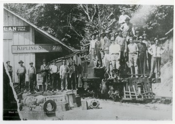Railroad workers are posing in front of a train at the C and K Railroad at MacFarlan Station in Ritchie County, West Virginia.