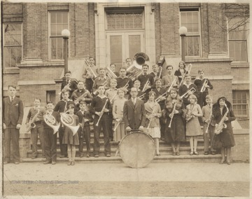 Group photo of the band members and instructor in the earlier part of the 20th century. Subjects unidentified.