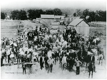 Court records and other valuables were forcibly removed from the courthouse at St. George on the night of August 1, 1893.  They were taken to Parsons and placed in a temporary courthouse the morning of August 2, 1893.  This photo, taken in Parsons, is looking northeast on Second Street.  It is accompanied by photo ID #015135.