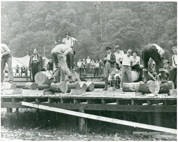 Men cutting logs for a contest in Webster County.