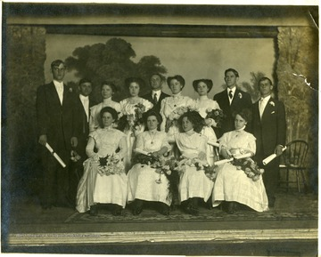 A group portrait of graduates of Old Kingwood Academy. Sixth from left is Isa Davis, mother of Dr. D. R. Davis, Kingwood.