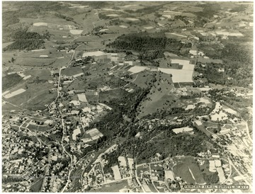 Facing Northeast.  At the bottom left if Stewart Street and the brighter street is Falling Run.  It runs vertical into Stewartstown Road.  Near the top is the WVU Animal Husbandry Farm.  About three inches in from the right top is the Mileground.  The large fields to the left are part of the WVU farms.  To their left is the WVU Horticulture Farm orchards.  About and inch and a half from the bottom right is the intersections of Willey Street, Snider Street, and Monongalia Avenue at Town Hill.