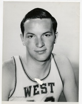 Portrait of John Lesher, member of the West Virginia University Basketball Team. 'Taylor Publishing Company, Job Number 07206, Picture Number 1, Page Number 223. Copyright 1963 by Laughead Photographers, Dallas, Texas. Reproduction permitted by all processes except photography.'