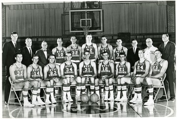 Row one- Bill Ryczaj, Ricky Ray, Bill Maphis, Marty Lentz, Bob Camp, Buddy Quertinmont, Rudy Zatezalo, Perry Polinsky, Bob Benfield.  Row two- Asst. Coaches Bob Lochmueller and Quentin Barnette, Equipment Mgr. Carl Roberts, Dave Palmer, Jerry Meadows, John Lesher, John Cavacini, Gary Shaffer, Mgr. Lance Kauf, Trainer Whitey Gwynne, Coach George King.