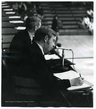Radio Announcers Jack Tennant and Jack Fleming call a game for the Mountaineers.