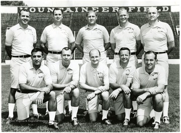 WVU football coaching staff.  Front row, from left:  Jimmy Ragland, Dale Evans, Phil Callicut, Bobby Bowden, Hayden Buckley.  Back row:  Jack Fligg, Marshall Taylor, Head Coach Jim Carlen, Bill Hicks, Dick Inman.