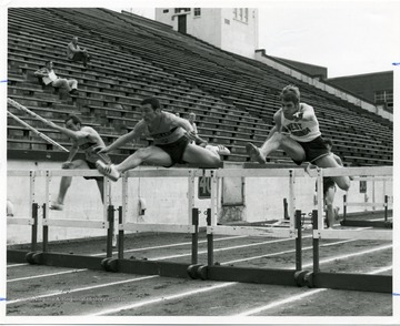 Hurdles competition between the track members of Ashland and West Virginia University.