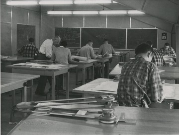 View of students in classroom of Engineering Science building.  Henry Speeden located left, with white shirt.