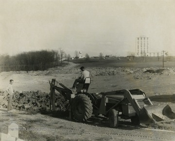 View of excavation at Evansdale.  Agriculture Engineering building pictured in background.