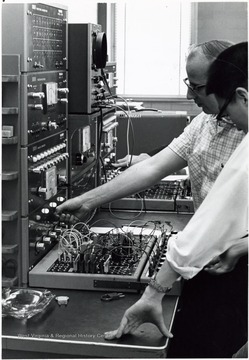 View of two men operating first (analog) computer at Engineering Sciences building.