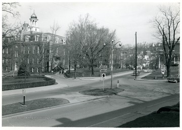 View of University Avenue at its intersection with College Avenue on the WVU Downtown campus.  Grumbein Island in center of street.  Martin Hall, Chitwood ('Science') Hall, and WVU Agricultural Experiment Station buildings visible.