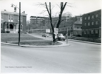 After 1957. WVU campus buildings from left to right, Agricultural Experiment Station, North Wing of Terrace (Dadisman) Hall under construction, Women's (Stalnaker)Hall, Cafeteria, Student Health Center.