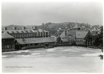 'Left to Right: Corner Mechanical Hall, Chemistry, old cafeteria (later used for buildings and grounds), Administration, & bleachers in back of Reynolds Hall.'
