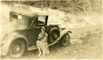 Hester Harr sitting on the siderail of an automobile. Biographical information on Hester Harr obtained from her niece, Debra Harr. Hester Harr was a patient at Hopemont Hospital for approximately 10 years. After contracting tuberculosis, she was admitted in the Spring of 1926 and discharged 1936. She was born January 10,1906 in Buena, W. Va. near Canaan Valley, one of five children (the third and last daughter) of John R. and DeLarie Harr. Hester graduated from Petersburg High School in 1925. She entered Shepherd College in the fall of that year. In the spring of 1926, she transferred to West Virginia University. Her brother, Guy Harr, born 1909, was also a student at WVU at the same time. He also contracted tuberculosis and entered the Hopemont Sanitarium. He died at Hopemont in 1934. After leaving Hopemont, Hester Harr married Harold Yokum of Keyser on December 31, 1938. They made their home in Ridgeley, W. Va. near Short Gap, W. Va. (on Rt. 28 South of Cumberland). They had no children. Harold Yokum died in 1953. Hester Harr died in 1987 of complications of pneumonia. She is buried in the Maple River Cemetery in Petersburg, W. Va.