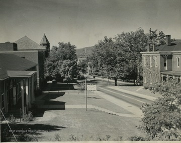 View of Grumbein Island, and left to right: Cafeteria, Health Center, Reynolds Hall, Tower of Administration building, Law School, President's home, Experiment Station.