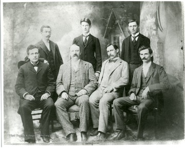 'Back row, left: W.E. Rumsey, Theodore Watson, Charles Howard?, Front row, left: A.D. Hopkins, Woollery ?, B.H. Hite, Lee Cleveland Corbett.'