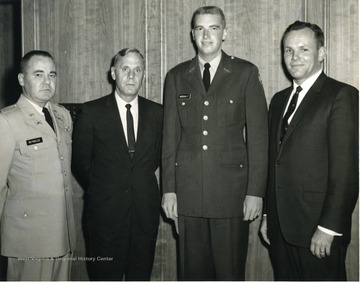 Left to right, Col. Reynolds, ROTC; WVU President, Paul A. Miller; K.T. Morgan, military graduate; Unknown.