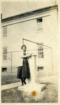 African-American student Ann Campbell of Charleston, W. Va. leaning against a pillar on the Storer College campus for a portrait.