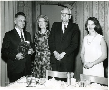 From left to Right: Dr. Patrick Gainer, English Professor, Mrs. Chitwood; Dr. Oliver P. Chitwood, retired History Professor and Bettijane Christopher Burger. At this staff appreciation dinner the yearbook was dedicated to Dr. Chitwood, and Dr. Gainer received an award for his many years of sponsorship to Monticola. Plaque reads:  'Monticola - To Dr. Patrick W. Gainer in appreciation for continuous dedication and service, from the 1967 staff'.