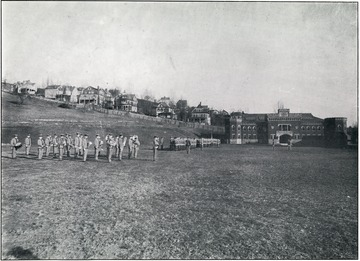 WVU R.O.T.C units and band on the Drill Field.  The Amory is visible in the background.
