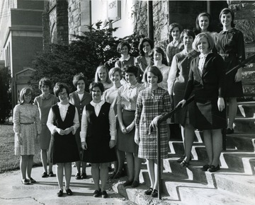 Members of Kappa Phi, Methodist Women pose out side of the Wesleyan church on the corner of North High Street and Willey Street.