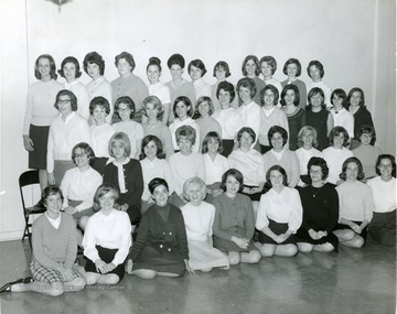 Members of Kappa Phi, Methodist Sorority line up in rows for a group portrait.