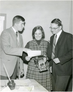 Left to right: Dave Burke, Sports; Joanne Bachner, Photo; Jim McCauley.