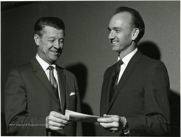'DEPARTMENTAL ASSISTANCE GRANT- Gulf Oil Company has given the chemical engineering department at West Virginia University a $1,000 unrestricted Departmental Assistance grant. Dr. Harry Heflin, left, University vice-president of administration and finance, accepts the grant from R.K. Pearson, recruitment adviser at Gulf's Philadelphia Refinery. The grant is one of 95 that Gulf is making this year to selected departments of many universities and colleges.'