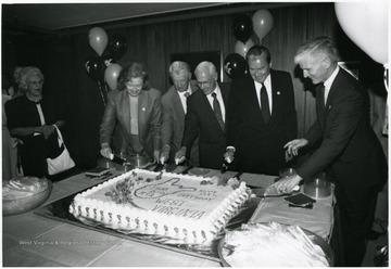 From left to right: Diane Reinhard, Harry Heflin, Paul Miller, Elvis J. Stahr, Neil S. Bucklew.