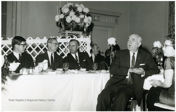 'At the table: Jack Canfield, Assistant to Governor Smith; Former WVU President Irvin Stewart; Former Governor W.W. Barron; Former Governor Okey Patterson; Mrs. Irvin Stewart on the extreme right.'