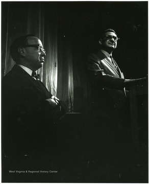 'History Symposium of Feb. 22-24 headlined Kentucky author Jesse Stuart and Arthur Schlesinger. Schlesinger is shown at left listening to Dr. John A. Caruso, chairman of the planning committee of the symposium at the Metropolitan Theatre.'